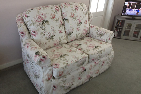 Two Seated Sofa looking like new